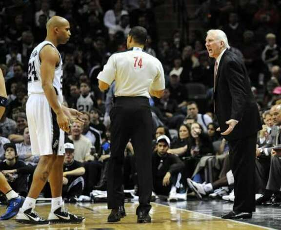 San Antonio Spurs head coach Greg Popovich and San Antonio Spurs small forward Richard Jefferson (24) argue a call with NBA official Curtis Blair during a NBA basketball game between the San Antonio Spurs and the Dallas Mavericks at the AT&T Center in San Antonio, Texas on November 26, 2010 John Albright / Special to the Express-News. (San Antonio Express-News)
