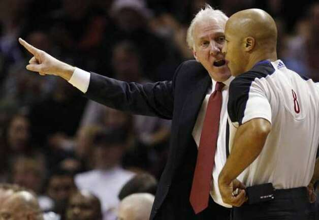 SPURS -- San Antonio Spurs Head Coach Gregg Popovich gets in the face of Marc Davis during second half against the Denver Nuggets at the AT&T Center, Wednesday, Dec. 22, 2010. The Spurs won 109-103. JERRY LARA/glara@express-news.net (San Antonio Express-News)