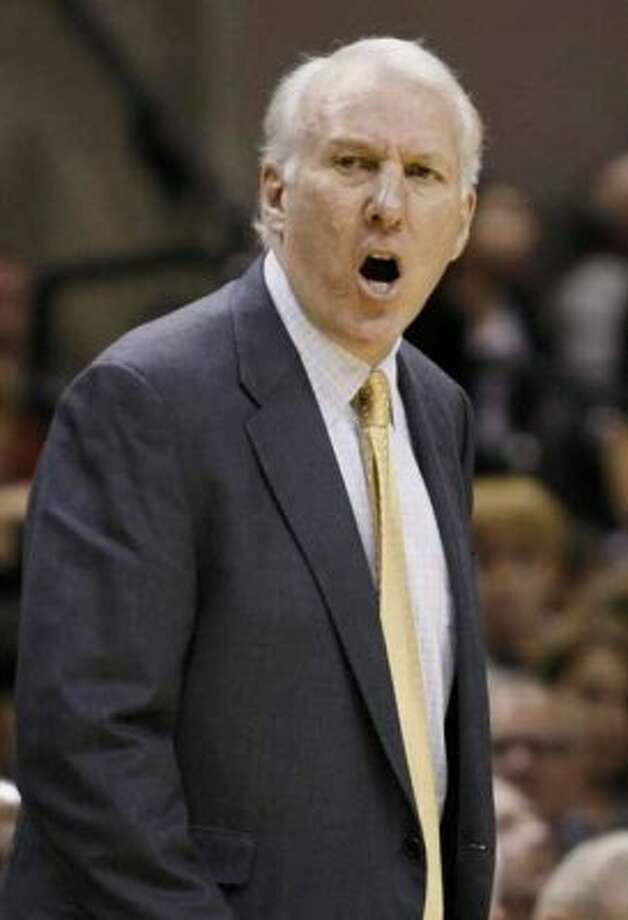 San Antonio Spurs head coach Gregg Popovich yells during the first half of an NBA basketball game against the Oklahoma City Thunder, Saturday, Jan. 1, 2011, in San Antonio. San Antonio won 101-74. (AP Photo/Darren Abate) (AP)