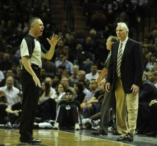 San Antonio Spurs coach Gregg Popovich watches as official Jason Phillips makes a call against his team during second-half NBA action against the Oklahoma City Thunder at the AT&T Center on Wednesday, Feb. 23, 2011. BILLY CALZADA / gcalzada@express-news.netOklahoma City Thunder at San Antonio Spurs (SAN ANTONIO EXPRESS-NEWS)