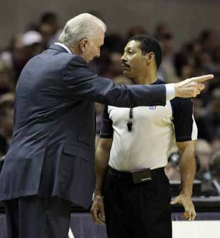 Spurs coach Gregg Popvich (left) exhanges words with game official Bill Kennedy during a game against New Jersey Nets in the first half at the AT&T Center on Friday, Feb. 25, 2011. Kin Man Hui/kmhui@express-news.net (SAN ANTONIO EXPRESS-NEWS)