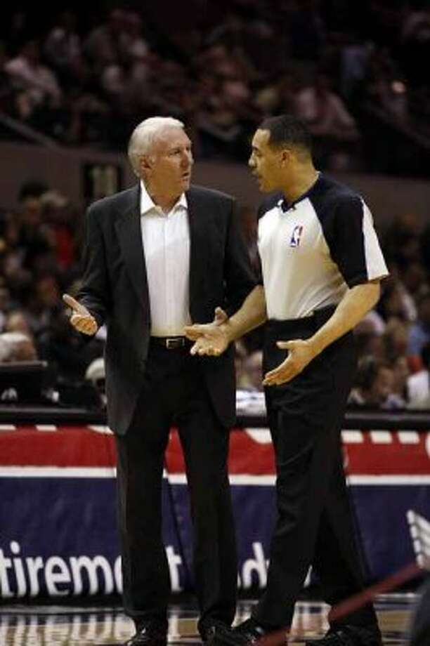 SPURS -- San Antonio Spurs Head Coach Gregg Popovich discusses a call with Official Curtis Blair in the first half against the Sacramento Kings at the AT&T Center, Wednesday, April 6, 2011. JERRY LARA/glara@express-news.net (San Antonio Express-News)