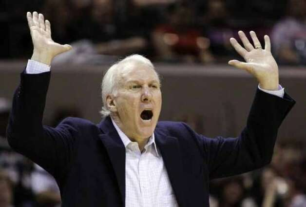 San Antonio Spurs coach Gregg Popovich reacts during the first quarter of an NBA basketball game against the Utah Jazz, Saturday, April 9, 2011, in San Antonio. (AP Photo/Eric Gay) (AP)