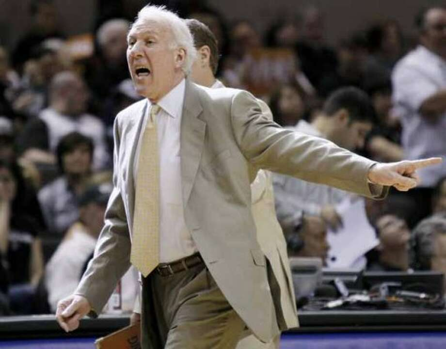 San Antonio Spurs head coach Gregg Popovich yells during the first half of an NBA playoff basketball game against the Memphis Grizzlies, Sunday, April 17, 2011, in San Antonio. (AP Photo/Darren Abate) (AP)