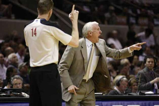 SPURS -- San Antonio Spurs Head Coach Gregg Popovich reacts to a call in their game against the Memphis Grizzlies in the NBA Western Conference First Round at the AT&T Center, Sunday, April 17, 2011. Next Popovich is official Ed Malloy.  JERRY LARA/glara@express-news.net (San Antonio Express-News)