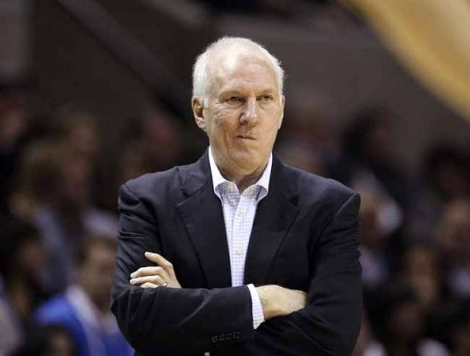 FOR SPORTS - San Antonio Spurs head coach Gregg Popovich looks on during first half action Thursday Jan. 5, 2012 at the AT&T Center.  (PHOTO BY EDWARD A. ORNELAS/eaornelas@express-news.net) (SAN ANTONIO EXPRESS-NEWS)