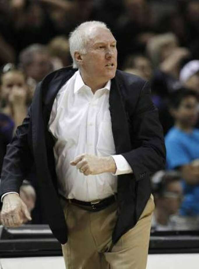 San Antonio Spurs coach Gregg Popovich reacts during overtime of an NBA basketball game against the Houston Rockets, Wednesday, Jan. 11, 2012, in San Antonio. San Antonio won 101-95 in overtime. (AP Photo/Eric Gay) (AP)