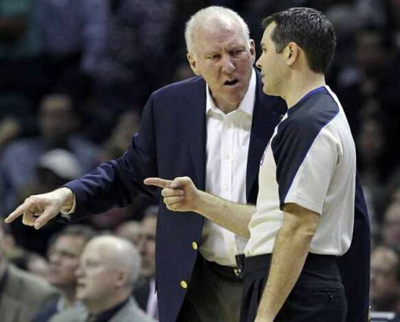 SPORTS   Greg Popovich argues a call with the referee as the Spurs play Sacramento at the AT&T Center in San Antonio on January 20, 2012 Tom Reel/ San Antonio Express-News (SAN ANTONIO EXPRESS-NEWS)