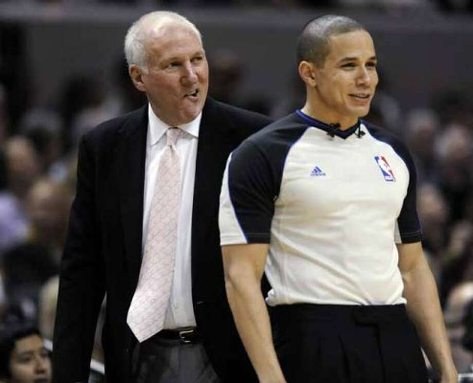 San Antonio Spurs coach Gregg Popovich questions a call with referee Steve Anderson during the second half of an NBA basketball game in San Antonio Thursday, Feb. 2, 2012. The Spurs defeated the New Orleans Hornets 93-81. (AP Photo/Bahram Mark Sobhani) (AP)