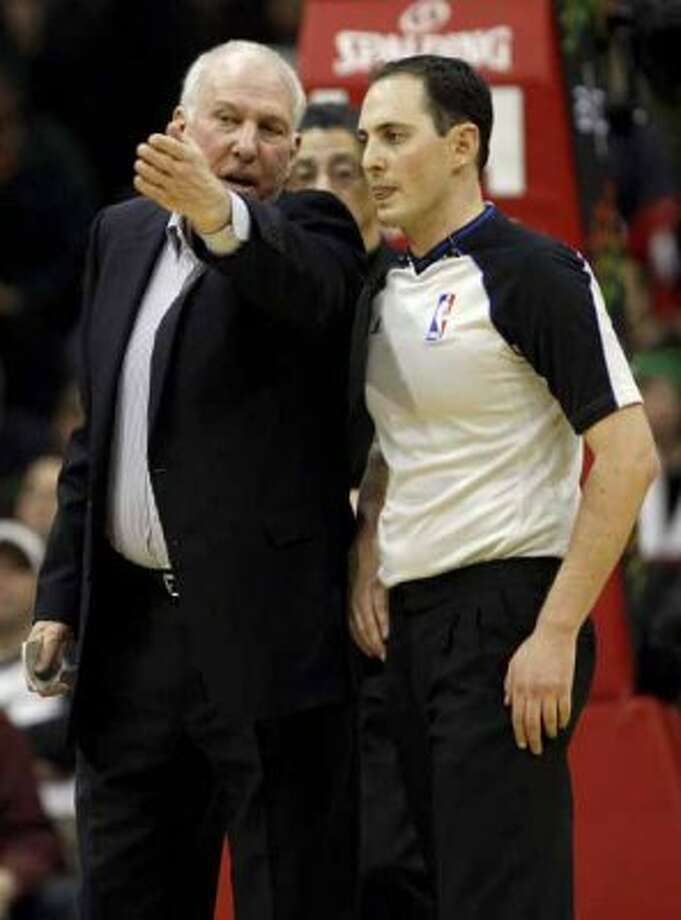 San Antonio Spurs head coach Gregg Popovich talks with official Marat Kobut in the first half against the New Jersey Nets during an NBA basketball game in Newark, N.J., Saturday, Feb. 11, 2012. The Spurs won 103-89. (AP Photo/Rich Schultz) (AP)