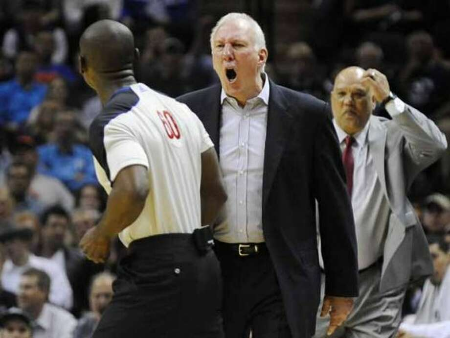 San Antonio Spurs head coach Gregg Popovich, center, yells at referee James Williams, left, before being ejected in the second half of an NBA basketball game against the New York Knicks, Wednesday, March 7, 2012, in San Antonio. San Antonio won 118-105. (AP Photo/Darren Abate) (AP)