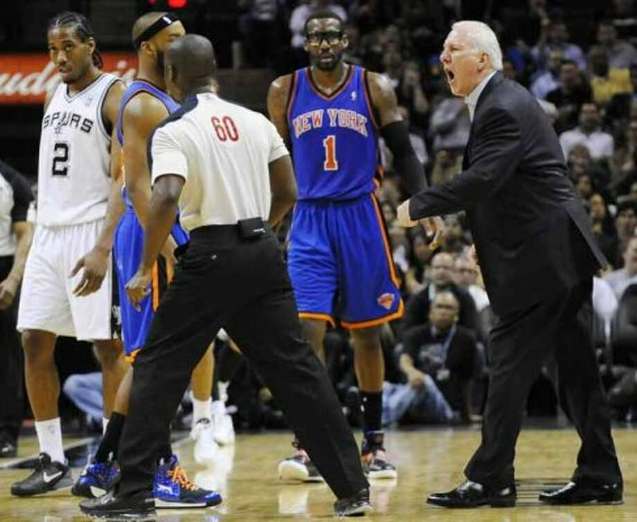 San Antonio Spurs head coach Gregg Popovich, right, continues to yell at referee James Williams (60) after being ejected in the second half of an NBA basketball game against the New York Knicks, Wednesday, March 7, 2012, in San Antonio. San Antonio won 118-105. (AP Photo/Darren Abate) (AP)