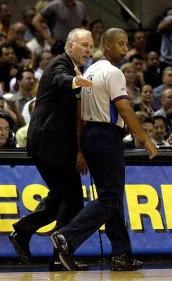 Spurs coach Gregg Popovich shares his thoughts with  referee Derek Stafford during first period action game 2 Western Conference semifinals at the SBC Center May 7, 2003. William Luther/Staff (SAN ANTONIO EXPRESS-NEWS)