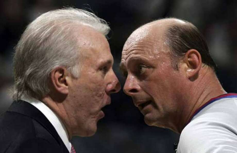 The Spurs Head Coach Gregg Popovich has a confrontational discussion with Blane Reichelt, an NBA referee in the fourth quarter of game 5 of the Western Conference semifinals at the SBC Center in San Antonio on Tuesday, May 17, 2005. (Kin Man Hui/staff) (SAN ANTONIO EXPRESS-NEWS)