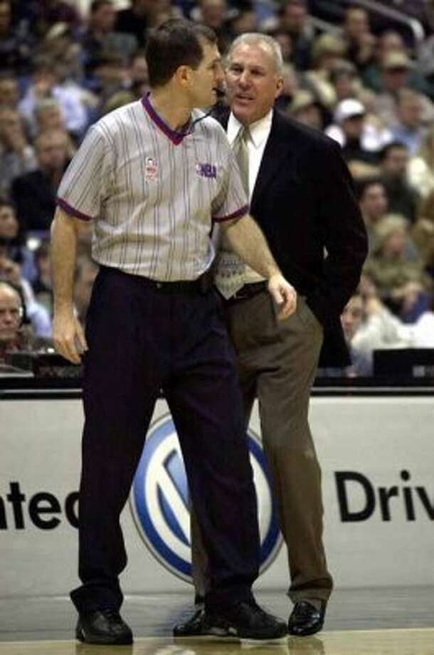 SPORTS - Spurs coach Gregg Popovich (right) screams at NBA referee Gary Benson and as a result gets tossed from the game against the Indiana Pacers on Friday, January 4, 2002. Kin Man Hui/staff. (SAN ANTONIO EXPRESS-NEWS)