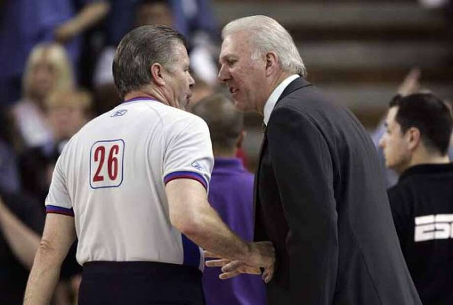 Spurs' coach Gregg Popovich (right) argues a call with a referee against Sacramento Kings' in the first half of Game 6 of the first round of the 2006 NBA Western Conference playoffs at the Arco Arena in Sacramento on Friday, May 5, 2006. (Kin Man Hui/staff) (SAN ANTONIO EXPRESS-NEWS)