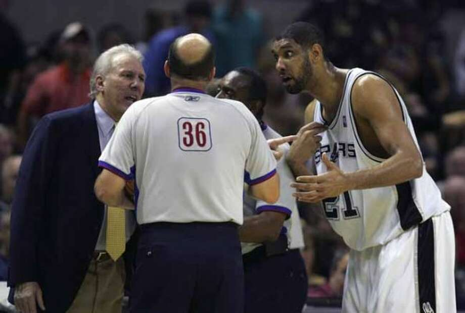 SPORTS   --- The Spurs' Gregg Popovich, left, and Tim Duncan talk Tuesday night May 9, 2006 at the AT&T Center  to the officials about a call during the second game of their Western Conference Semi-Finals match-up against the Dallas Mavericks.         (BAHRAM MARK SOBHANI/STAFF) (SAN ANTONIO EXPRESS NEWS)