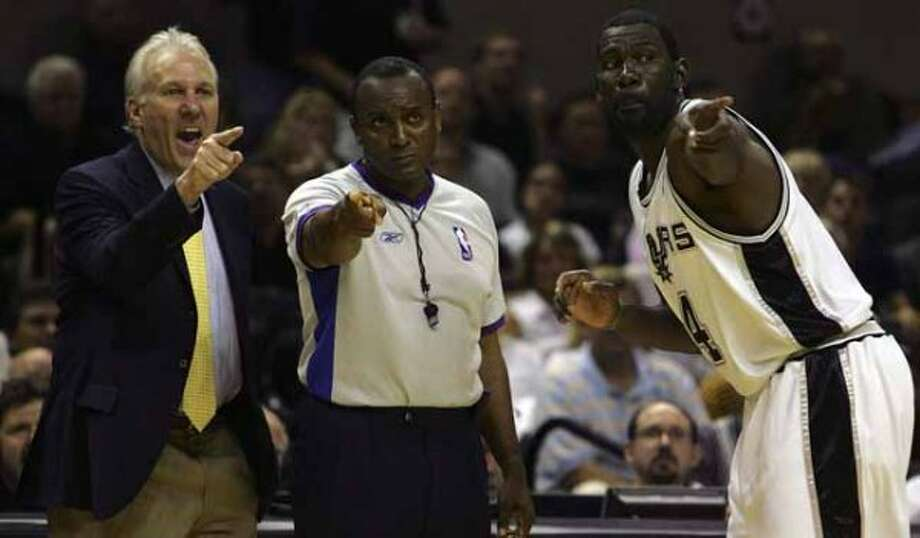 SPORTS   ---  Coach Gregg Popovich and Michael Finley argue with ref Eddie Rush in the fourth quarter Tuesday night May 9, 2006 at the AT&T Center during the second game of their Western Conference Semi-Finals match-up. The Spurs lost 91-113.       (BAHRAM MARK SOBHANI/STAFF) (SAN ANTONIO EXPRESS NEWS)