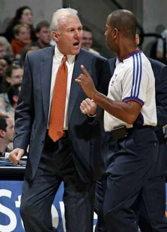 SPORTS   Spurs coach Greg Popovich expresses his displeasure with the officiating in the game against the Knicks Saturday night at the AT&T Center.   SAN ANTONIO SPURS VERSUS NEW YORK KNICKS AT THE AT&T CENTER   TOM REEL/STAFF  NOVEMBER 11, 2006. (SAN ANTONIO EXPRESS-NEWS)
