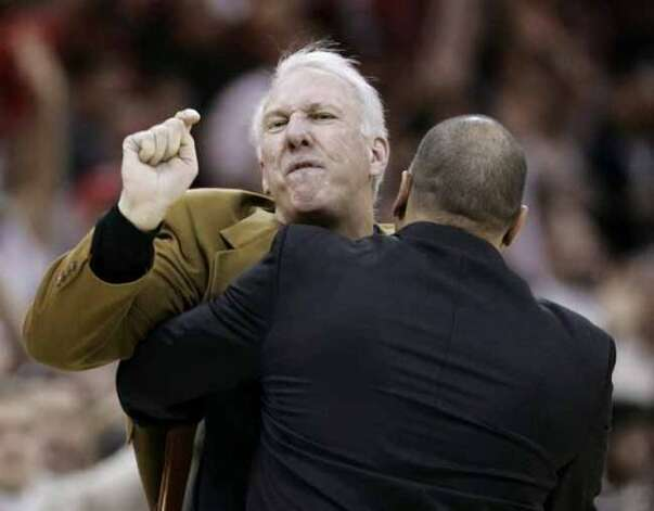 San Antonio Spurs head coach Gregg Popovich, left, is held back by assistant coach Don Newman after Popovich was ejected during the fourth quarter of an NBA basketball game Tuesday, Jan. 2, 2007, in Cleveland. The Cavaliers won 82-78. (AP Photo/Tony Dejak) (AP)