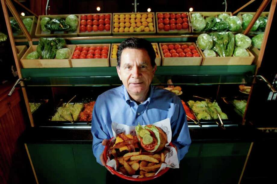 Fuddruckers, various locations:Started by then-San Antonian Phil Romano in 1980, this chain is known for its fresh beef grilled to order, house-baked buns and Build Your Own toppings bar. www.fuddruckers.com Photo: Julio Cortez, Chronicle / Houston Chronicle