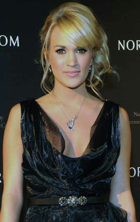 NASHVILLE, TN - FEBRUARY 28:  Singer/songwriter Carrie Underwood attends the Nordstrom Symphony fashion show at the Schermerhorn Symphony Center on February 28, 2012 in Nashville, Tennessee.  (Photo by Rick Diamond/Getty Images) Photo: Rick Diamond, Staff / 2012 Getty Images