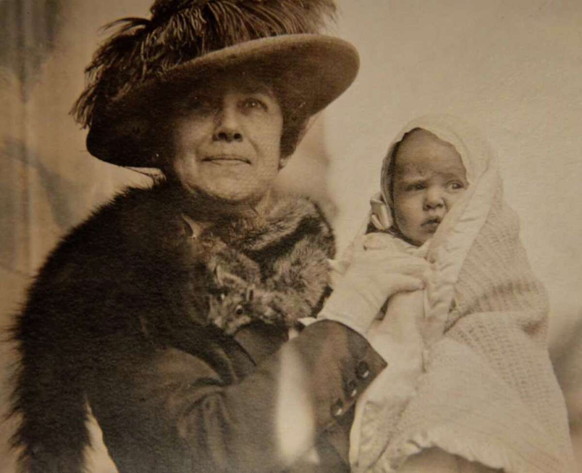 Helen Churchill Candee, who survived the sinking of the Titanic, holds one of her grandchildren, circa 1917.