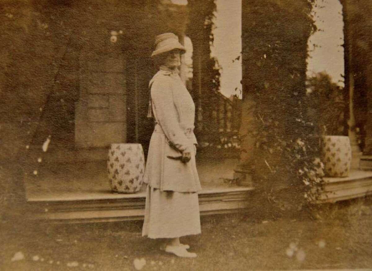 Helen Churchill Candee poses for a photo alongside the Veranda of Elm Park, now the Lockwood-Mathews Mansion Museum, circa 1913.