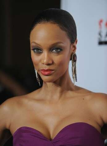 "Tyra Banks has since gone on to become a media mogul, with a talk show, her reality show ""America's Next Top Model"" and a degree from Harvard Business School. She's seen here in November 2011, age 37. (Dimitrios Kambouris / Getty Images)"