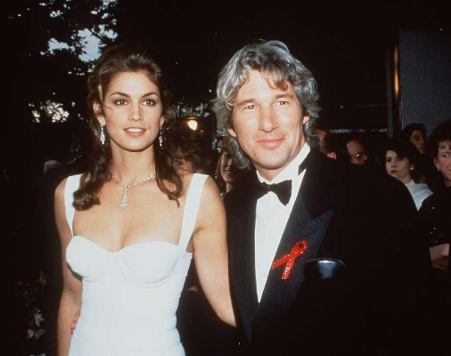 Cindy Crawford, with then-husband Richard Gere, in 1991 at 25. Crawford, known for her trademark mole, was one of the biggest supermodels in the late '80s and early '90s.  (Brenda Chase / Getty Images)