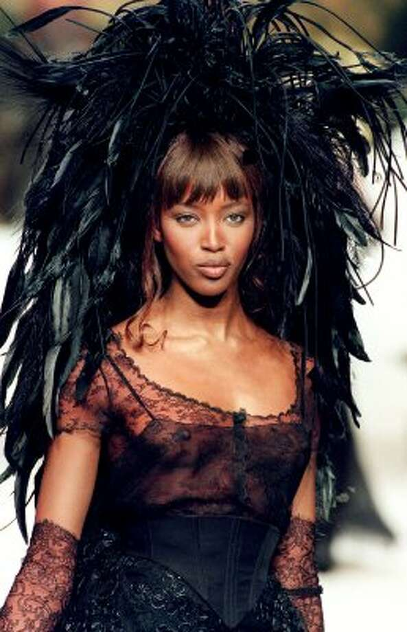 Top model Naomi Campbell walks the runway during Chanel's 1994 Spring/Summer haute couture collection, at age 24.  (AFP/Getty Images)