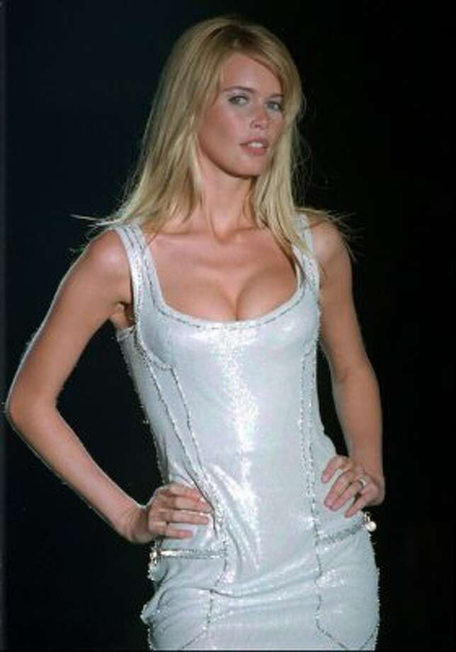 Claudia Schiffer walks the runway in Gianni Versace's haute couture collection in 1995, age 24.  (Lionel Cironneau / ASSOCIATED PRESS)