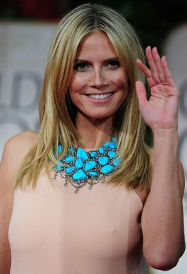 "Model Heidi Klum in January, 2012, age 38. Klum is now better known as the executive producer and judge on ""Project Runway."" (FREDERIC J. BROWN / AFP/Getty Images)"