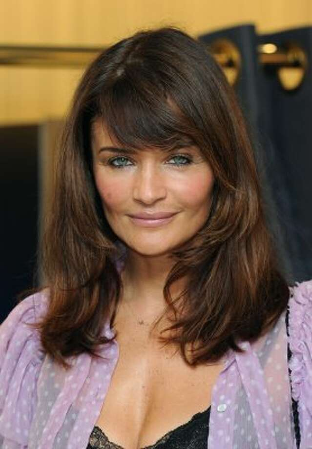 Now a photographer, Helena Christensen is seen here in February 2012, age 43.   (Gareth Cattermole / Getty Images)