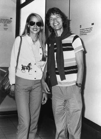 Fashion model Jerry Hall, seen here with then-boyfriend Rolling Stones singer Mick Jagger, in 1981, age 25.  Hall was one of the most in-demand models of the mid-to-late '70s. (AFP/Getty Images)
