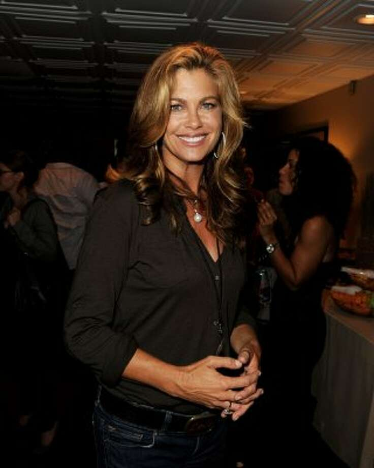 Model Kathy Ireland in September 2011, age 47. Thanks to her Kathy Ireland line of clothing and products, she's now estimated to be worth $350 million, according to Forbes.  (Kevin Winter / Getty Images)