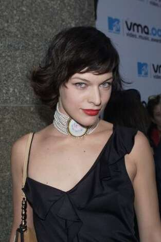 "At age 11, Milla Jovovich was chosen by photographer Richard Avedon to be one of Revlon's ""Most Unforgettable Women in the World,"" launching her modeling career. Here she is at the 2000 MTV Video Music Awards at age 24.  (Frank Micelotta / Getty Images)"