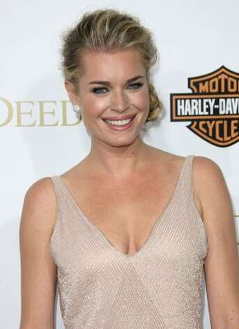 "Rebecca Romijn, seen here in Feb. 2012 at age 39, is now an actress, having appeared in the ""X-Men"" films and ""Ugly Betty."" (Frederick M. Brown / Getty Images)"