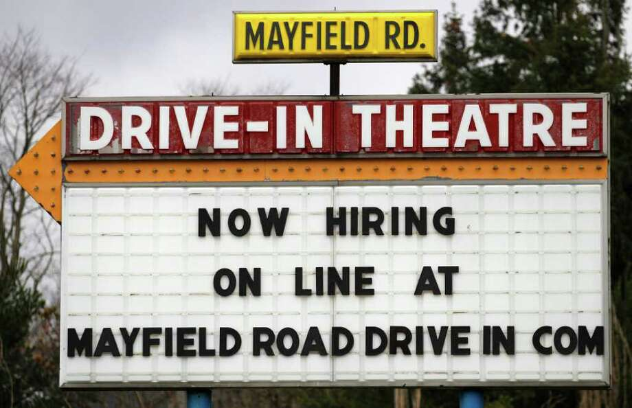 In this Thursday, March 8, 2012 photo, a help-wanted sign displays outside the Mayfield Drive-In movie theater in Chardon, Ohio. U.S. employers added 227,000 jobs in February to complete three of the best months of hiring since the recession began. The unemployment rate was unchanged, largely because more people streamed into the work force. The Labor Department said Friday, March 9, 2012, that the unemployment rate stayed at 8.3 percent last month, the lowest in three years. (AP Photo/Amy Sancetta) Photo: Amy Sancetta / AP