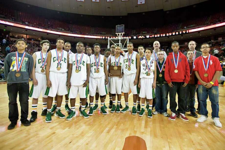 The Cole Cougars pose for a  team photo following their 2A state semifinal game with Brock at the Frank Erwin Center in Austin on March 9, 2012.  Brock defeated the Cougars 60-55.  MARVIN PFEIFFER/ mpfeiffer@express-news.net Photo: MARVIN PFEIFFER, Marvin Pfeiffer/ Express-News / Express-News 2012
