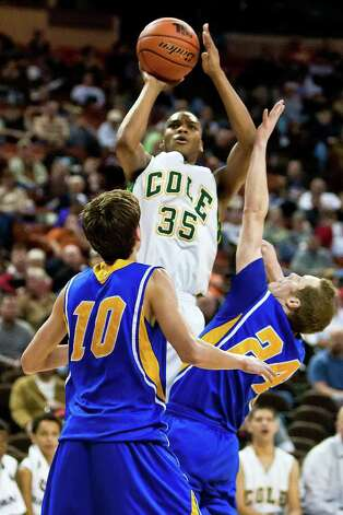 Cole's Ronnel Jordon goes up for a jump shot over Brock's Dylan Carrigan (right) and Kelley Clark duriing the second quarter of their state semifinal game with Brock at the Frank Erwin Center in Austin on March 9, 2012.  Brock defeated the Cougars 60-55.  MARVIN PFEIFFER/ mpfeiffer@express-news.net Photo: MARVIN PFEIFFER, Marvin Pfeiffer/ Express-News / Express-News 2012