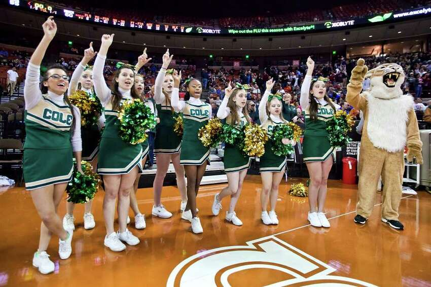 Cole's cheerleaders and mascot give a cheer following the Cougar's state semifinal game with Brock at the Frank Erwin Center in Austin on March 9, 2012. Brock defeated Cole 60-55. MARVIN PFEIFFER/ mpfeiffer@express-news.net