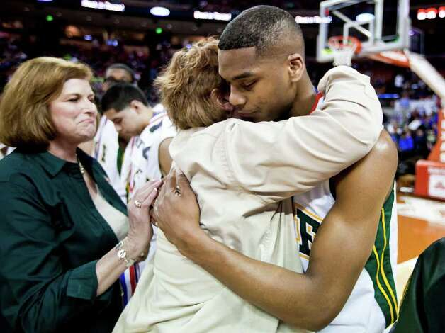 Cole principal Isabelle Clayton gives senior Ronnel Jordan a hug following during the medal ceremony folowing the Cougar's state semifinal game with Brock at the Frank Erwin Center in Austin on March 9, 2012.  Brock defeated Cole 60-55.  MARVIN PFEIFFER/ mpfeiffer@express-news.net Photo: MARVIN PFEIFFER, Marvin Pfeiffer/ Express-News / Express-News 2012