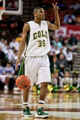 Cole's Ronnel Jordan sets up a play duriing Cole's state semifinal game with Brock at the Frank Erwin Center in Austin on March 9, 2012.  Jordan Led all scorers with 36 points though the Cougars fell to Brock 60-55.  MARVIN PFEIFFER/ mpfeiffer@express-news.net Photo: MARVIN PFEIFFER, Marvin Pfeiffer/ Express-News / Express-News 2012