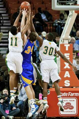 Cole's Andre Terrell (left) and Kendrick Taylor battle for a rebound with Brock's Drake Osborn duriing their state semifinal game at the Frank Erwin Center in Austin on March 9, 2012.  Brock defeated the Cougars 60-55.  MARVIN PFEIFFER/ mpfeiffer@express-news.net Photo: MARVIN PFEIFFER, Marvin Pfeiffer/ Express-News / Express-News 2012