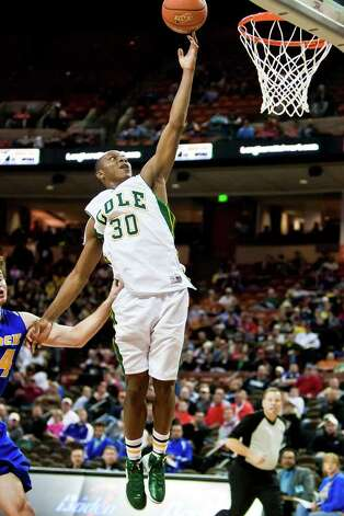 Cole's Kendrick Taylor puts up a layup duriing their state semifinal game with Brock at the Frank Erwin Center in Austin on March 9, 2012.  Brock defeated the Cougars 60-55.  MARVIN PFEIFFER/ mpfeiffer@express-news.net Photo: MARVIN PFEIFFER, Marvin Pfeiffer/ Express-News / Express-News 2012