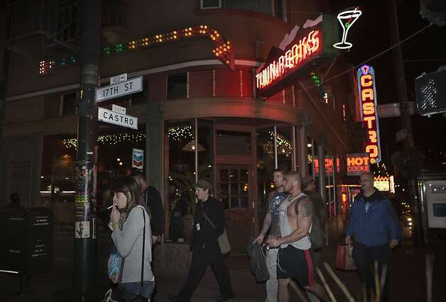 Pedestrians passing by Twin Peaks Tavern in San Francisco Calif.,  on Friday, February 24, 2012. Photo: Liz Hafalia, The Chronicle
