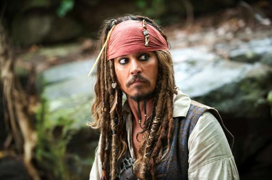 "Capt. Jack Sparrow has sailed through four ""Pirates of the Caribbean"" movies so far. (Disney / AP)"