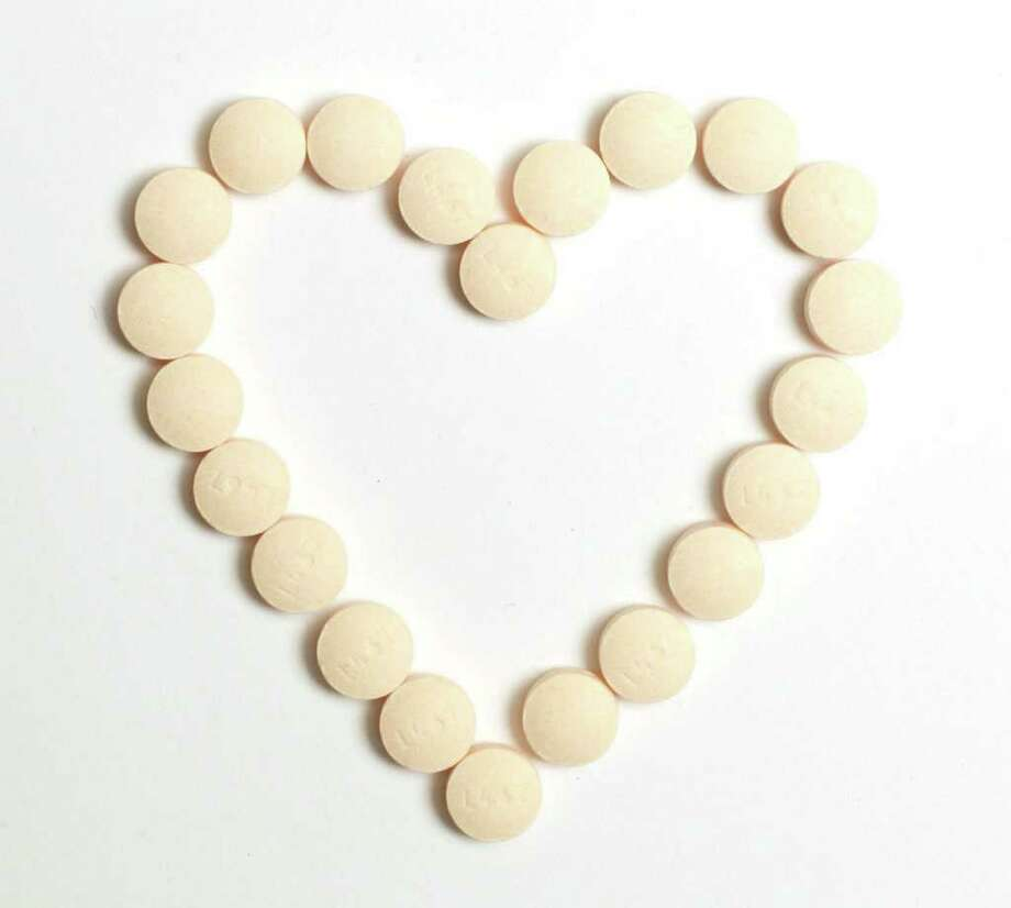 Cardiologists in the U.K. have found that not everyone benefits from taking a daily aspirin to prevent heart attack. Photo: Charles Bertram / Lexington Herald-Leader