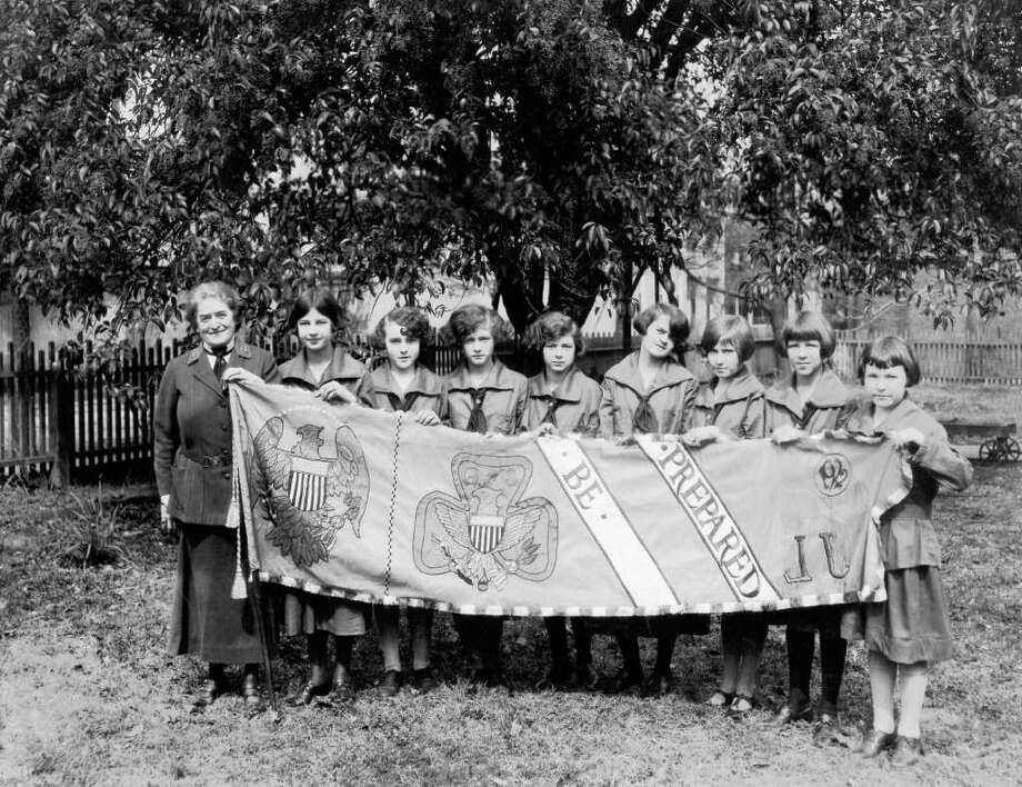 "Juliette Gordon Low: ""Daisy holding one end of the founder's banner in 1922 on the tenth anniversary of Girl Scouting."" Credit: Girl Scouts of the USA-Juliette Gordon Low Birthplace. Used by Permission Photo: Girl Scouts Of The USA"